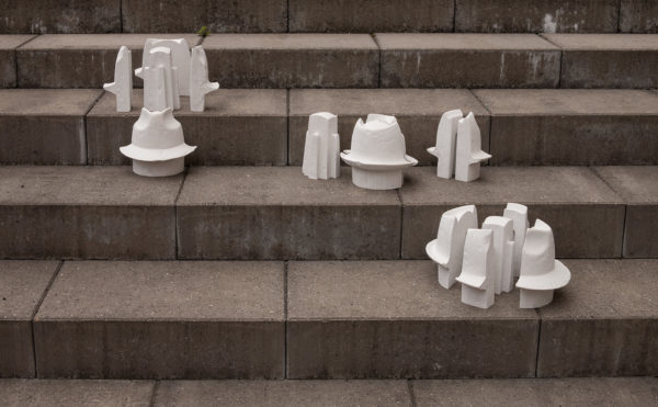 Kristina Bengtsson - Three hats in conversation on a staircase - white concrete, 15 parts, dimensions variable - 2015